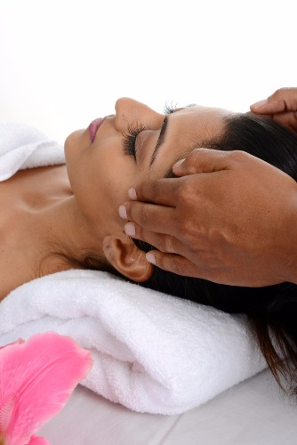 Woman receiving Indian head massage