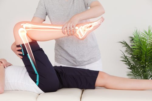 Woman receiving sports massage therapy in supine position