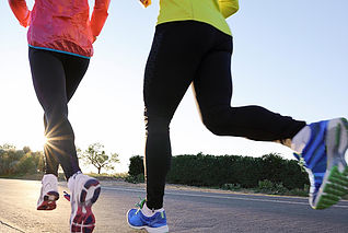 Image of two female runners on the road